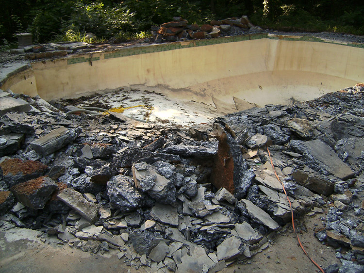 pool with concrete coping and deck removed